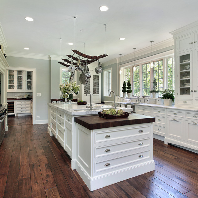 Kitchen in luxury home with white cabinetry.jpg