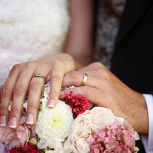 Wedding rings, jewellery, flowers, hands
