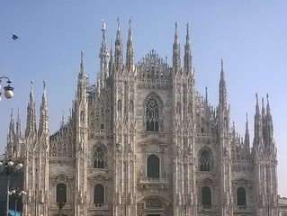 Why should you visit Milan?