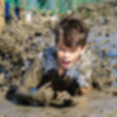 Crawl nets at Mud Kids are just an excuse to get closer to the mud!