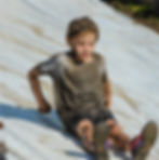 One of our very own Mud Kids testing the slide