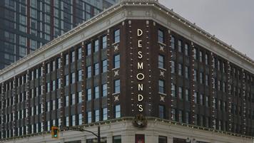 Desmond's Dept Store Exterior Establishing; with post graphic