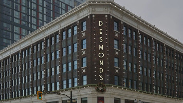 Desmond's Dept Store Exterior Establishing; with post graphic