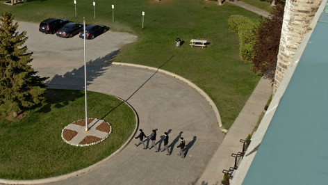 Military School Exterior Flagpole; retrofitted, dressed location