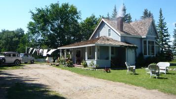 Farmhouse circa 1945; retrofitted, dressed location