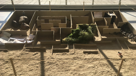Excavation I; plywood, balsa wood, sand, 3-D figures, moss, glass, books, paper, 8' x 8'; Sculpting New Words, Toronto Harbourfront