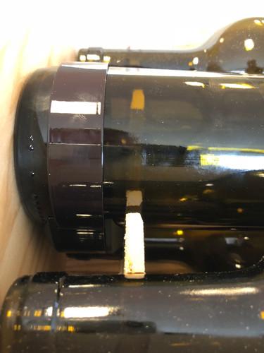 Détail du positionnement d'un veilleur bouteille une fois en caisse