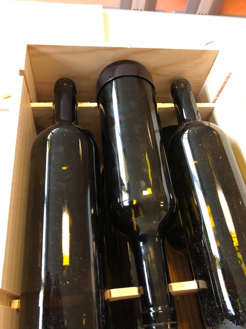 Caisse équipée d'une bouteille avec veilleur