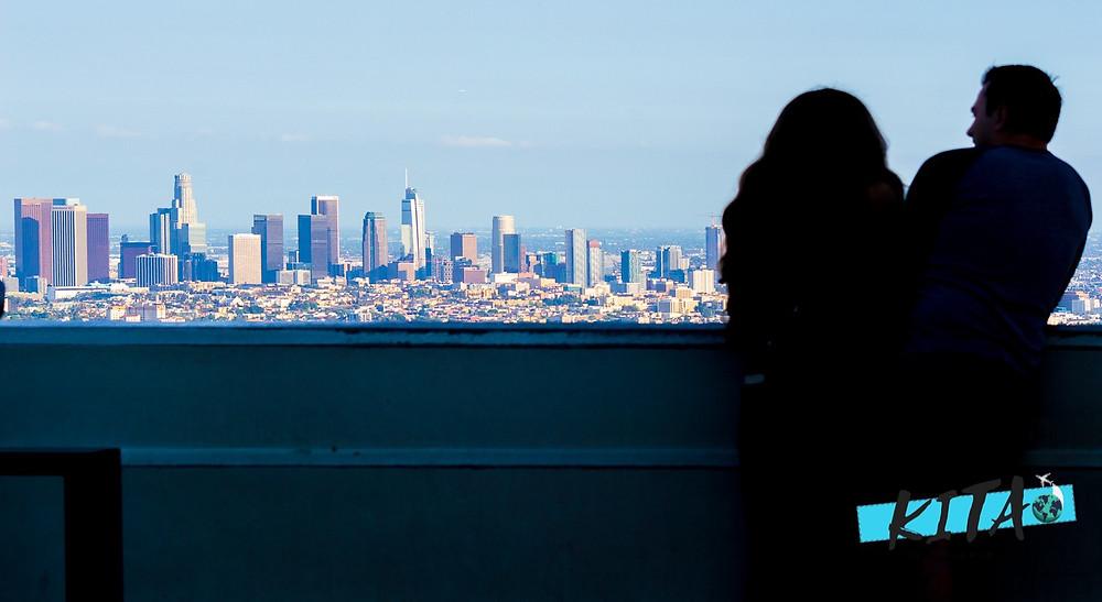 Photo of Couple Overlooking Downtown LA