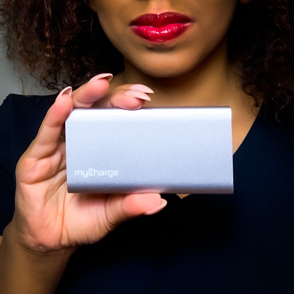Me holding the myCharge portable charger