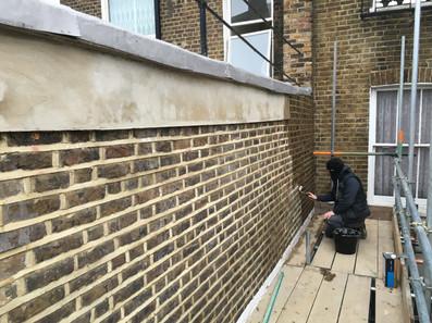 Brick wall repointing