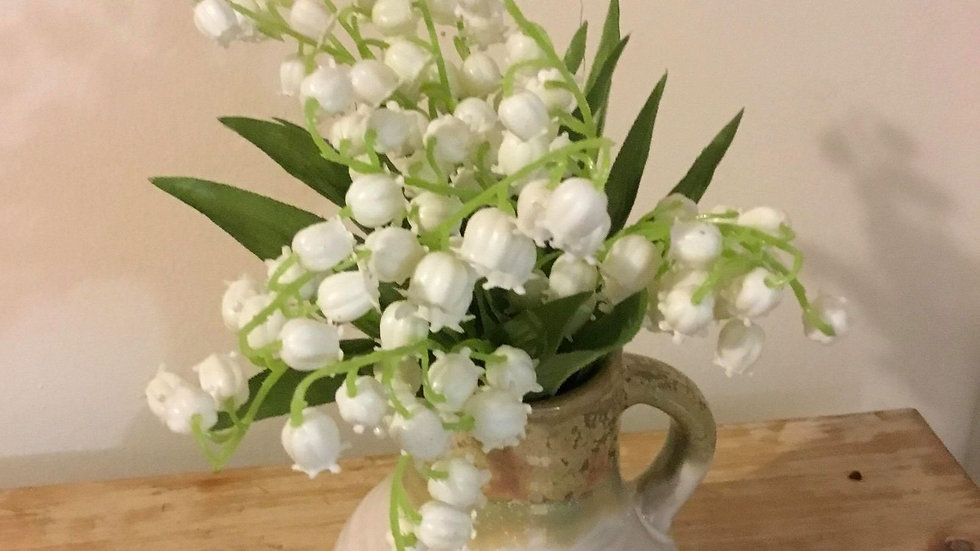 Lily of the Valley arrangement in a cream/taupe mini jug.