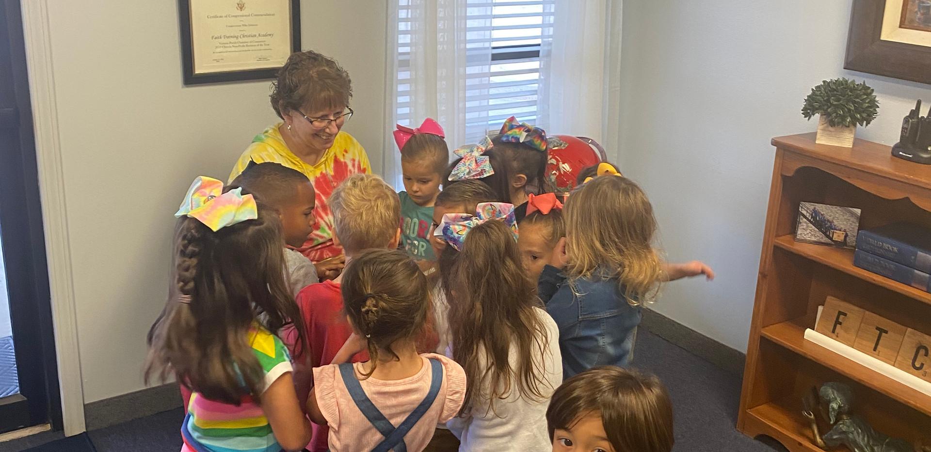 Ms. Henry's K4 class reading to Nurse Stolfi.