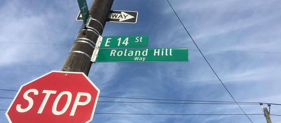 "Corner of E 14th St. & Ave X Becomes ""Roland Hill Way"""