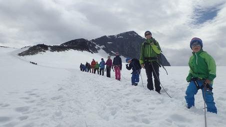 Three families going home after reaching Galdhøpiggen