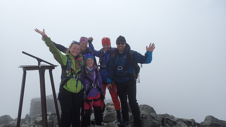 Family on top of Galdhøpiggen, Norway´s highest peak