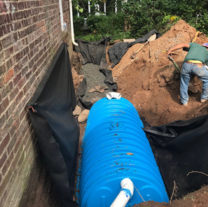 Installing seepage pits for drainage