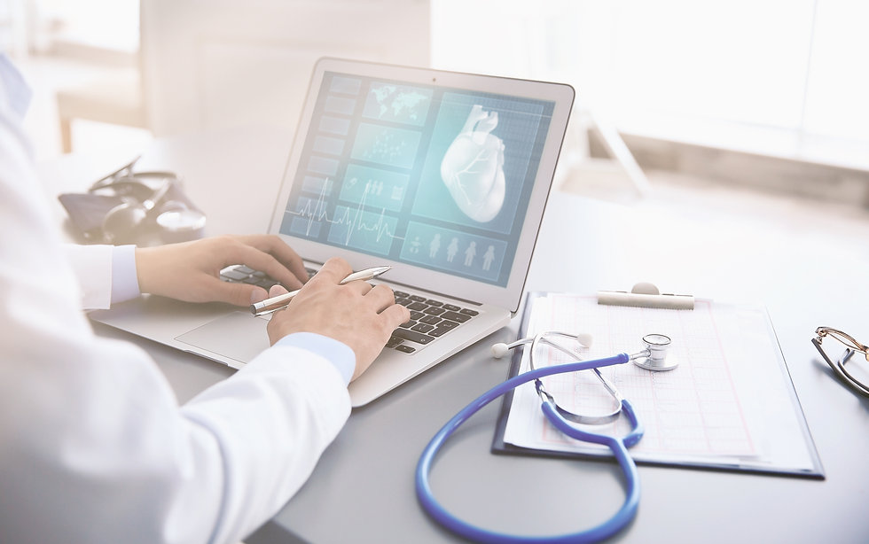 Cardiologist working with laptop at offi