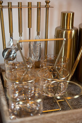 brass bar tools, vintage glasses and bar tray