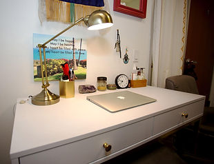 private office desk and gold lamp
