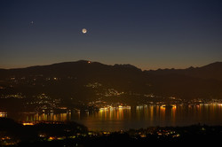 evening lake view with moon and jupiter setting