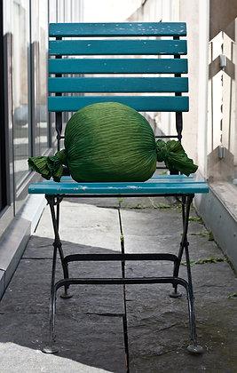 Grünes Bonbonkissen