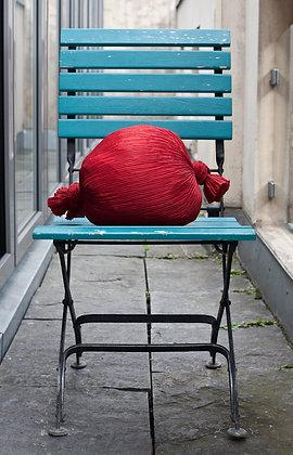 Rotes Bonbonkissen