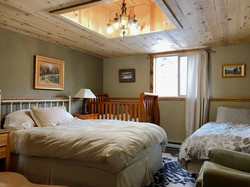 A bedroom with an additional twin and crib too! - in the Guest Lodge