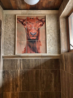 Custom artistic details at the Guest Lodge - even in the shower!