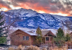 Guest Lodge with the mountains of Yellowstone in the background