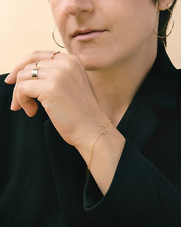 Gold Standard, a study of gold as a minimal yet elegant accent to everyday wear. Featuring jewelry by Vrai and Oro. Photography by Sharon Radisch