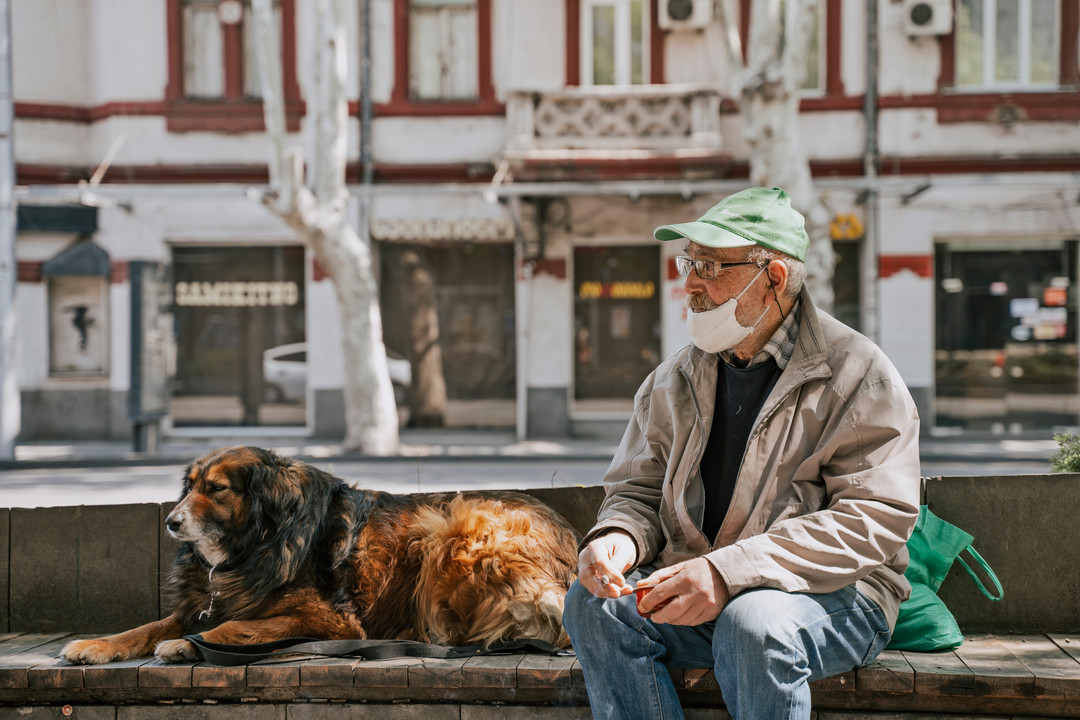 an old man with dog