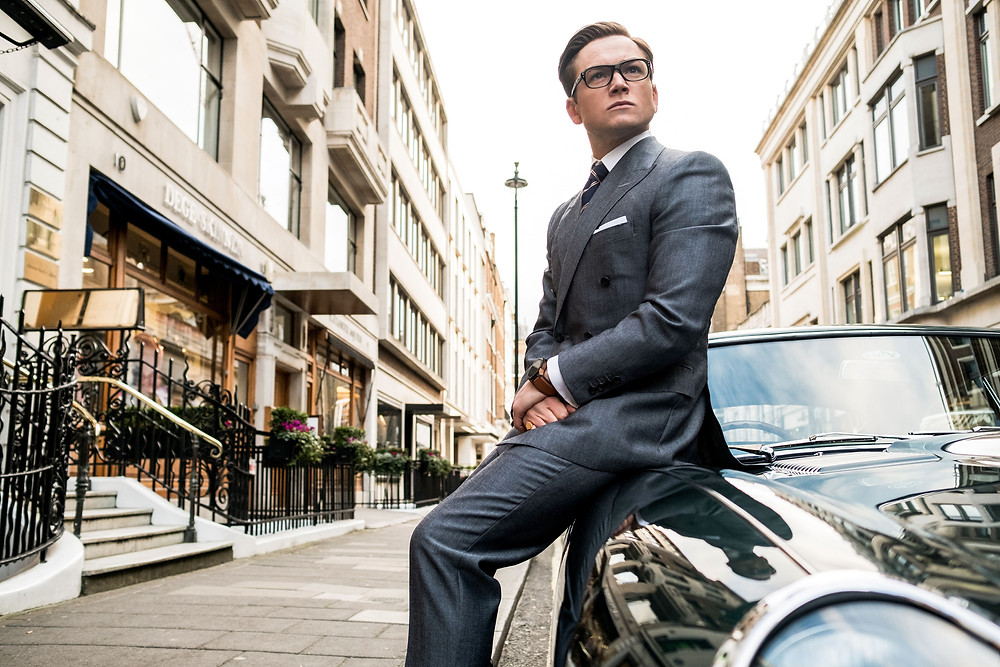 "Taron Egerton stars in Twentieth Century Fox's ""Kingsman: The Golden Circle,"" also starring Colin Firth, Julianne Moore, Channing Tatum, Mark Strong, Elton John, Halle Berry and Jeff Bridges.] Taron Egerton stars in Twentieth Century Fox's ""Kingsman: The Golden Circle"" Photo Credit: Giles Keyte - TM & © 2017 Twentieth Century Fox Film Corporation. All Rights Reserved. Not for sale or duplication."