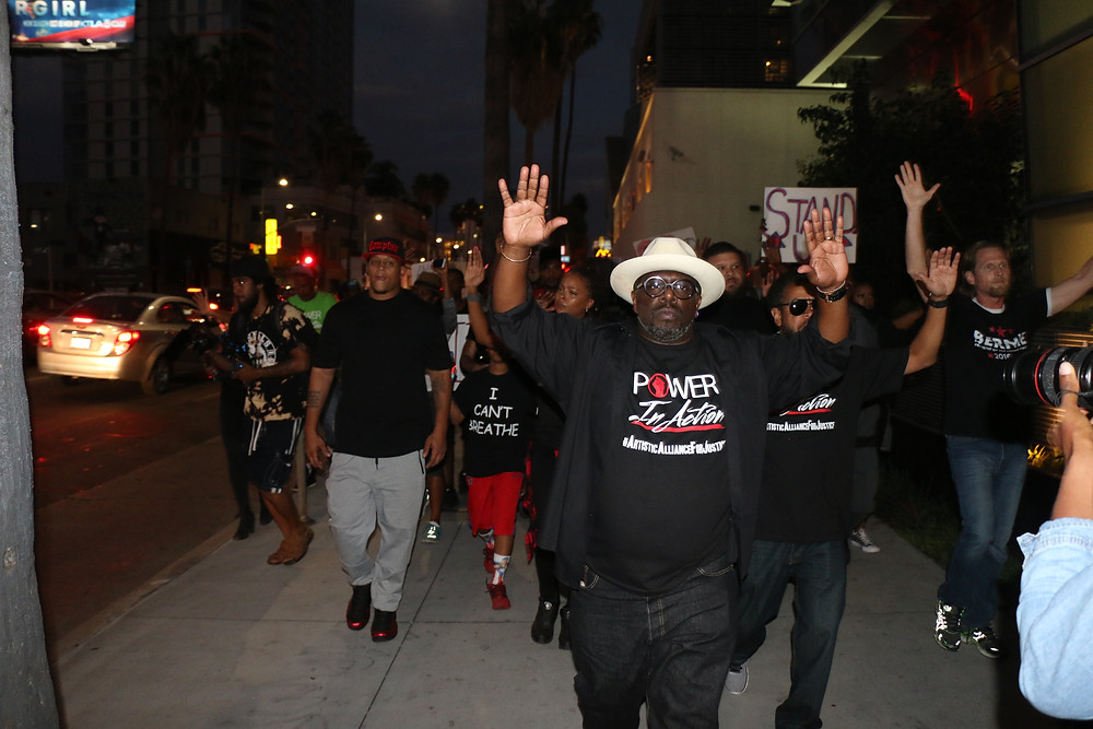 Comedian, Cedric the Entertainer leading the 'Power in Action' march (Photo by: Thai Lee)