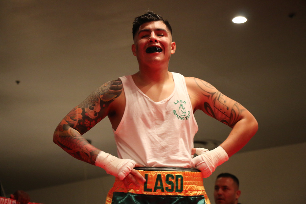 Proud LASD boxer in the ring supporting those fighting for their lives (Pictured by: Thai Lee)