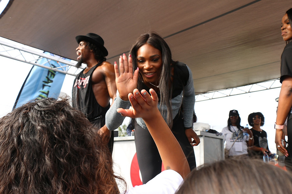 Serena high-fiving a young fan (Photo by: Thai Lee)