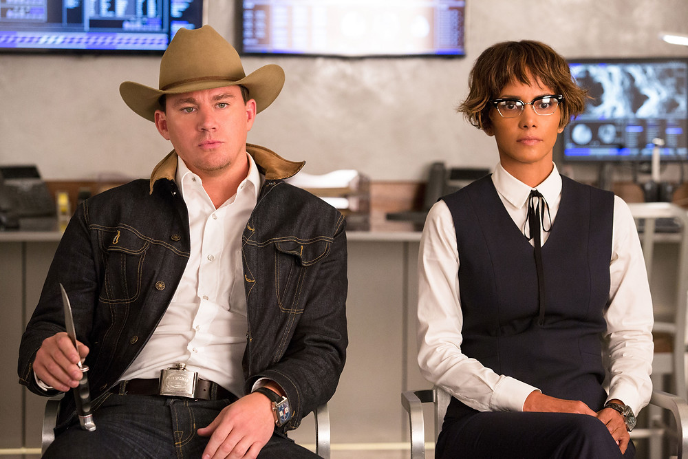 "Channing Tatum and Halle Berry in Twentieth Century Fox's ""Kingsman: The Golden Circle,"" also starring Colin Firth, Taron Egerton, Julianne Moore, Mark Strong, Elton John, and Jeff Bridges.] Channing Tatum and Halle Berry in Twentieth Century Fox's ""Kingsman: The Golden Circle"" Photo Credit: Giles Keyte - TM & © 2017 Twentieth Century Fox Film Corporation. All Rights Reserved. Not for sale or duplication."