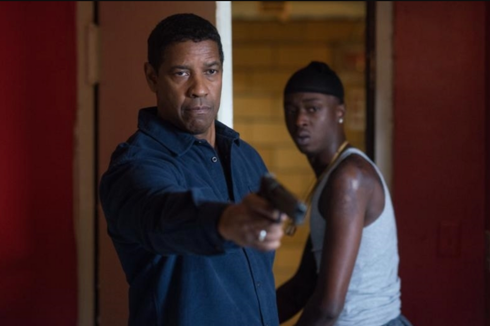 Miles (ASHTON SANDERS) is protected by Robert McCall (DENZEL WASHINGTON) in Columbia Pictures' THE EQUALIZER 2. --- Photo Credit: Glen Wilson ©2018