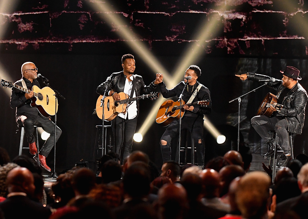 Jonathan Butler, Travis Greene, Jonathan McReynolds and Israel Houghton performing at the 32nd Annual Stellar Awards | Photo Credit: Earl Gibson, Courtesy of Central City Productions/TV One; Arnold Turner, Courtesy of Central City Productions/TV One