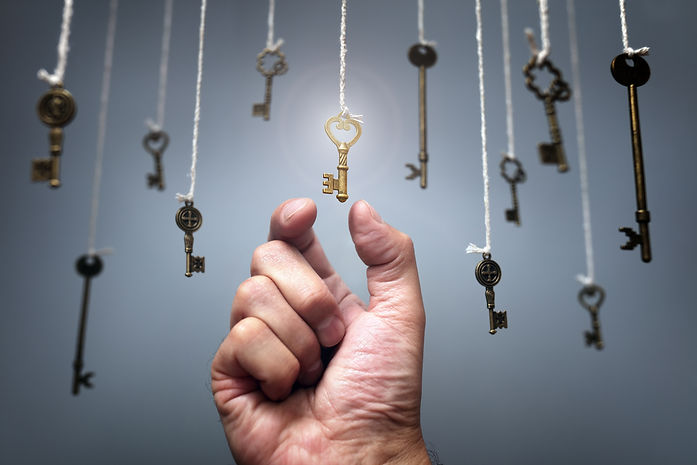 Choosing the key to success from hanging keys concept for aspirations, achievement and incentive.jpg