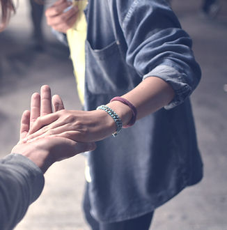 man and woman holding hands on street_edited_edited.jpg