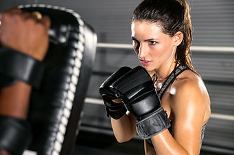 Woman fighter ready to throw a punch wit