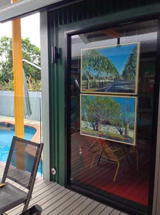 Absurditree series paintings in the studio window