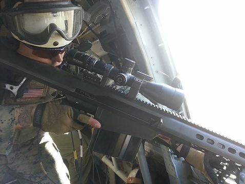 Owner/Instructor Guy Higgins taking shots on a target during an Aerial Sniper Mission.
