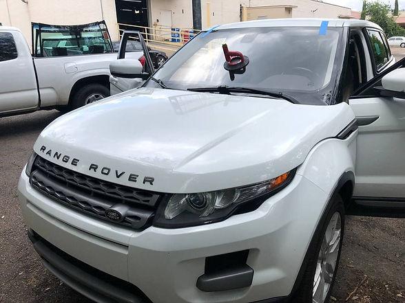 White 2012 Range Rover Evoque windshield repair