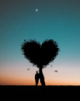 silhouette-photo-of-man-leaning-on-heart