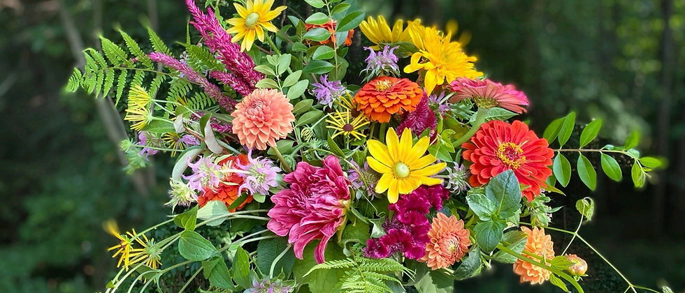 Large vase arrangement available for florist delivery. Lush mix of local flowers in bright colors.