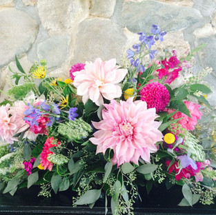 Wedding mantle arrangement using local flowers.