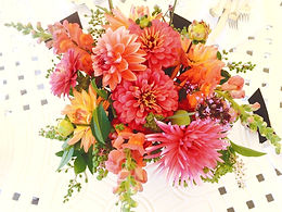 A bouquet of pink, peach and coral cut flowers available for florist delivery in Asheville, NC. Flowers include dahlias, zinnias and snapdragons.