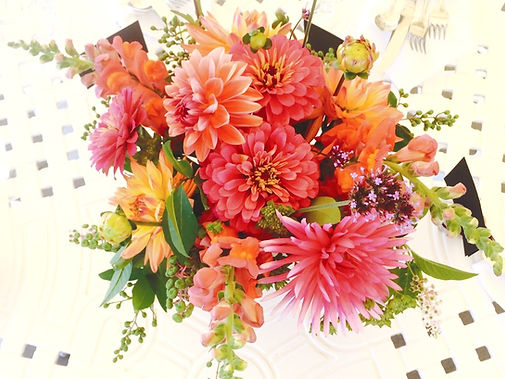 Vase bouquet of local farm flowers available for florist delivery. Pink, coral and orange flowers include dahlias, zinnias and snapdragons.
